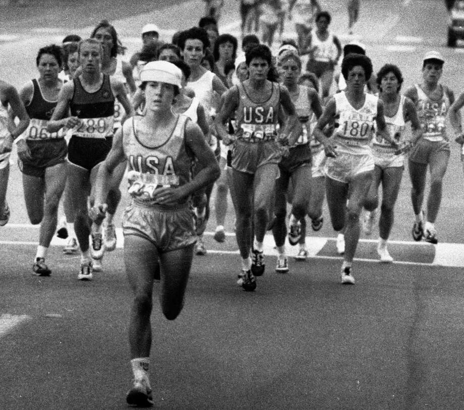 FILE -- Joan Benoit, of the U.S., breaks away from the pack on her way to winning the first Olympics women's marathon during the 1984 Summer Olympic Games in Los Angeles, Aug. 5, 1984. Before 1984, women were not allowed to compete in the marathon due to the fear that they weren't strong enough or that they might damage their reproductive organs. (Ron Heflin/Pool via The New York Times) Photo: RON HEFLIN / 1984 AP