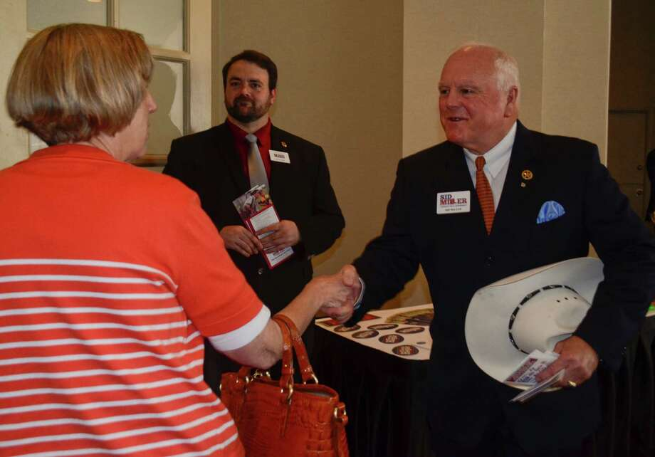 Sid Miller, running for Texas Agriculture Commissioner, greets Jo Sneed Wednesday before the Midland County Republican Women's luncheon. Tim Fischer\Reporter-Telegram Photo: Tim Fischer, Photographer