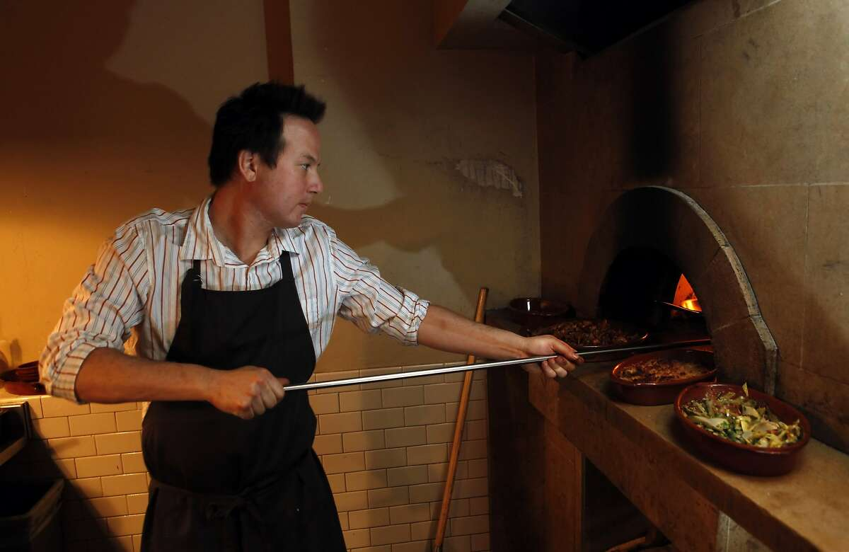 Woodfired oven filled with food at Camino restaurant in Oakland, Calif., on Wednesday, October 7, 2009. Chef/owner Russell Moore is doing the cooking.