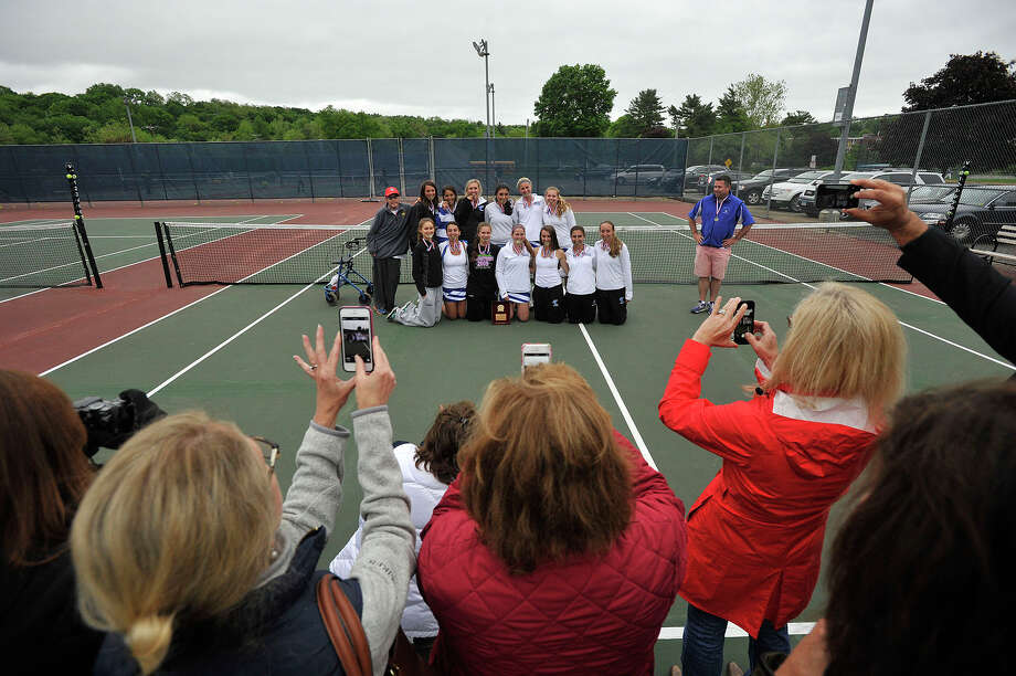 The Fairfield Ludlowe girls tennis team poses for a photograph with their FCIAC title after defeating Greenwich at Wilton High School in Wilton, Conn., on Wednesday, May 28, 2014. Photo: Jason Rearick / Stamford Advocate