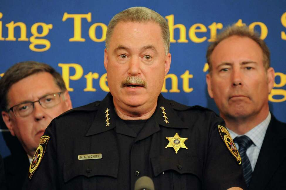 Sullivan County Sheriff Mike Schiff, center, speaks about his daughter, a heroin addict, at the Joint Task Force on Heroin and Opioid Addiction news conference on Tuesday, May 28, 2014, at the Capitol in Albany, N.Y. (Cindy Schultz / Times Union)