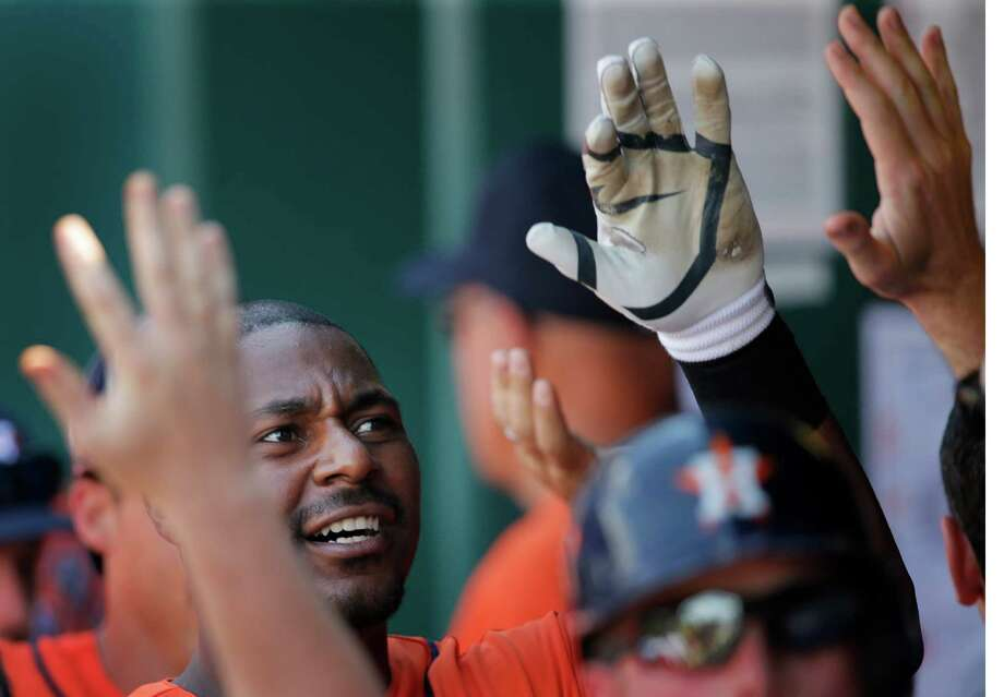 Chris Carter re-entered the lineup with a bang - make that a double bang - that made him a hit with Astros teammates Wednesday. Photo: Orlin Wagner, STF / AP