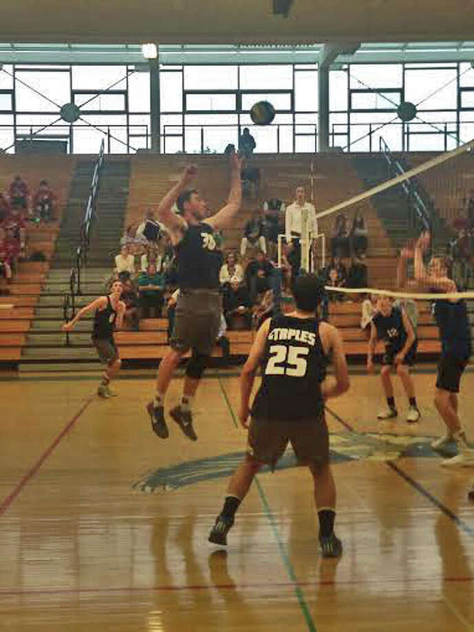 Staples senior Todd Goldstein goes up for a kill during FCIAC semifinals against Darien on Wednesday evening at Fairfield Ludlowe High School. Staples won 3-1. Photo: Ryan Lacey/Staff Photo / Westport News Contributed