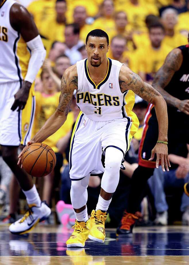 INDIANAPOLIS, IN - MAY 28: George Hill #3 of the Indiana Pacers brings the ball up the floor against the Miami Heat during Game Five of the Eastern Conference Finals of the 2014 NBA Playoffs at Bankers Life Fieldhouse on May 28, 2014 in Indianapolis, Indiana. NOTE TO USER: User expressly acknowledges and agrees that, by downloading and or using this photograph, User is consenting to the terms and conditions of the Getty Images License Agreement. Photo: Andy Lyons, Getty Images / 2014 Getty Images