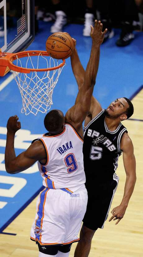 OKLAHOMA CITY, OK - MAY 27: Cory Joseph #5 of the San Antonio Spurs dunks on Serge Ibaka #9 of the Oklahoma City Thunder in the second half during Game Four of the Western Conference Finals of the 2014 NBA Playoffs at Chesapeake Energy Arena on May 27, 2014 in Oklahoma City, Oklahoma. NOTE TO USER: User expressly acknowledges and agrees that, by downloading and or using this photograph, User is consenting to the terms and conditions of the Getty Images License Agreement. Photo: Joe Robbins, Getty Images / 2014 Getty Images