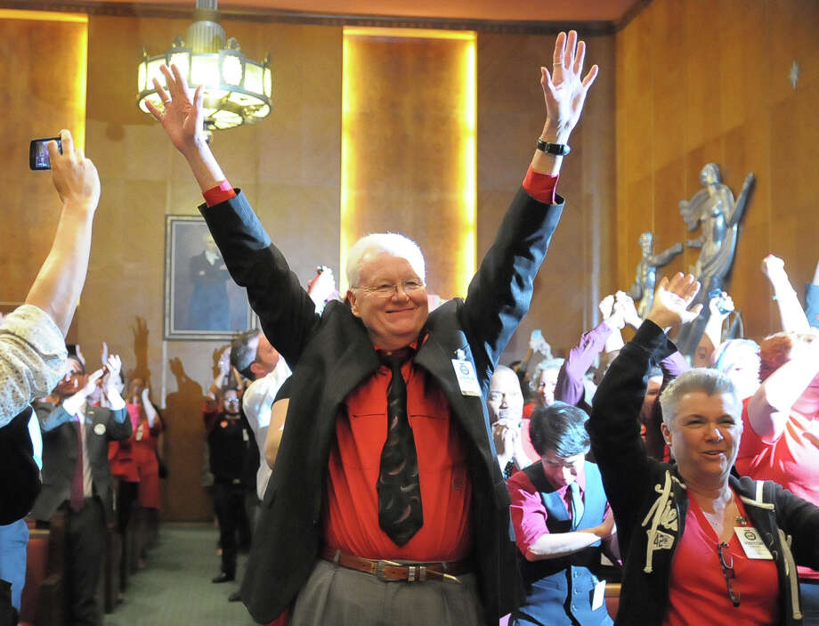 Randall Beaman and Debbie Kelly show their approval when Houston City Council voted to approve the Equal Rights ordinance Wednesday May 28, 2014. Photo: © Tony Bullard 2014, Tony Bullard / © Tony Bullard & the Houston Chronicle