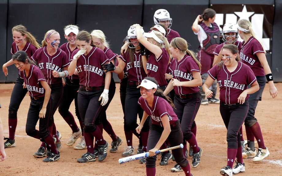 The East Bernard softball team celebrates a Miranda Lehmann home run during the sixth inning of the 2A state softball tournament against Hawley at McCombs Field on Wednesday, May 28, 2014, in Austin. Photo: J. Patric Schneider, For The Chronicle / © 2014 Houston Chronicle