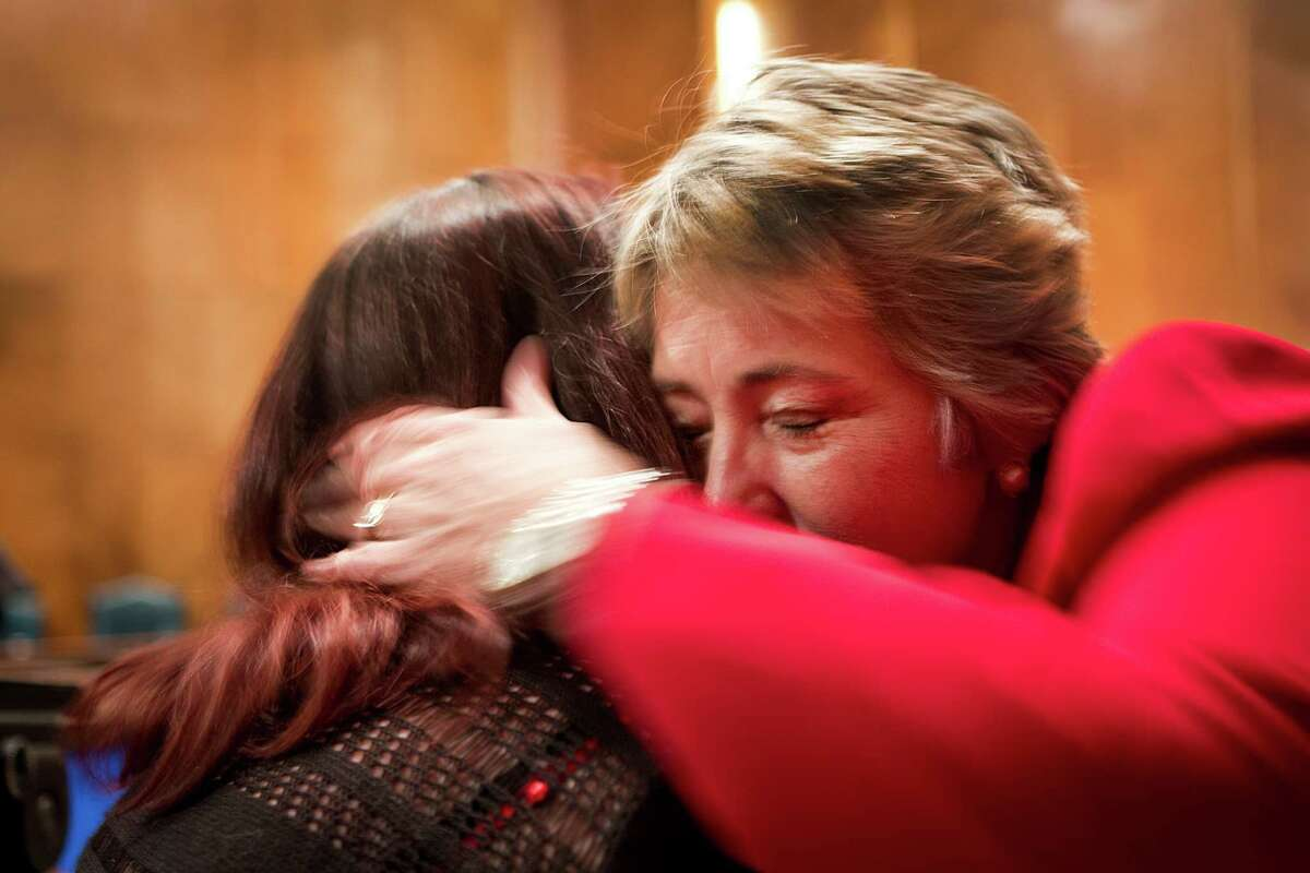 Mayor Annise Parker embraces Autumn Packard, the mother of a transgender daughter, who approached the mayor to thank her for pushing the equal rights ordinance at the council meeting on Wednesday.