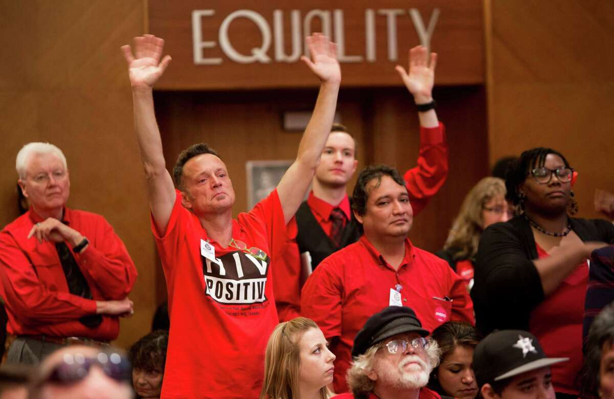 Supporters of the equal rights ordinance encourage speakers in favor of the proposal on Wednesday.