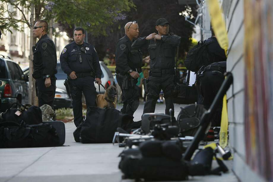 San Francisco Police gear up to respond to a call of a suspected gunman in San Francisco, Calif. on Wednesday, May 28, 2014. A suspected gunman barricaded himself in a house near the corner of 23rd and Shotwell St. Photo: James Tensuan, The Chronicle