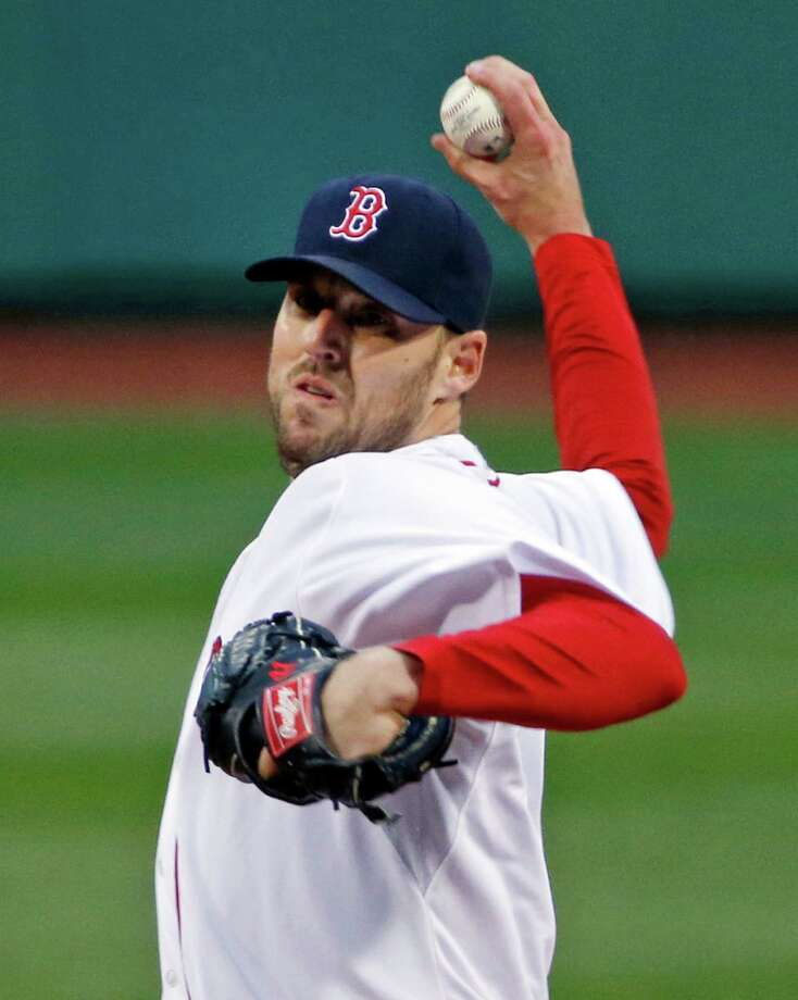 Boston Red Sox starting pitcher John Lackey delivers to the Atlanta Braves in the first inning of a baseball game at Fenway Park in Boston, Wednesday, May 28, 2014. (AP Photo/Elise Amendola) ORG XMIT: MAEA113 Photo: Elise Amendola / AP