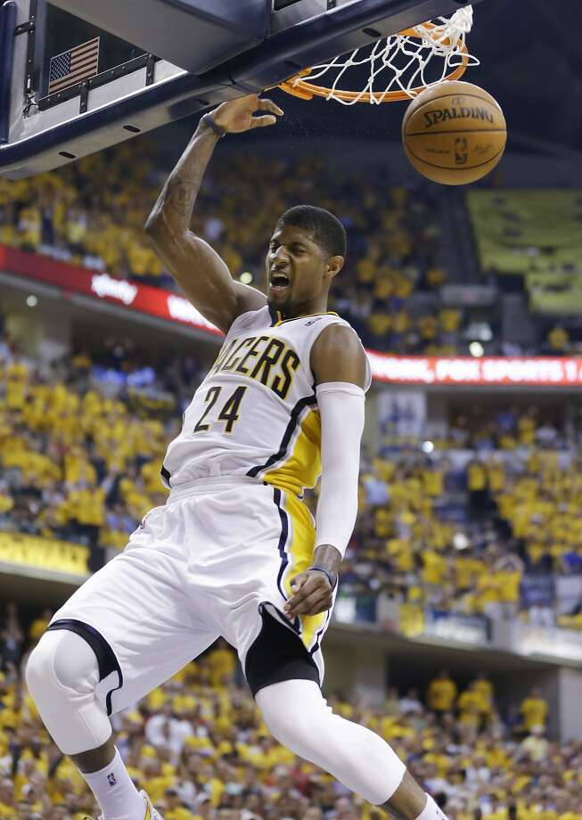 Paul George dunks while scoring 31 of the Pacers' final 52 points in the comeback win. Photo: Michael Conroy, Associated Press