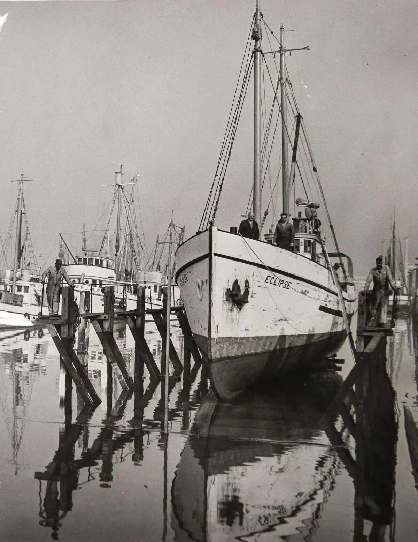 October 1965 Captain Adolph Samuelson, Dale Samuelson on bow of halibut schooner Eclipse.