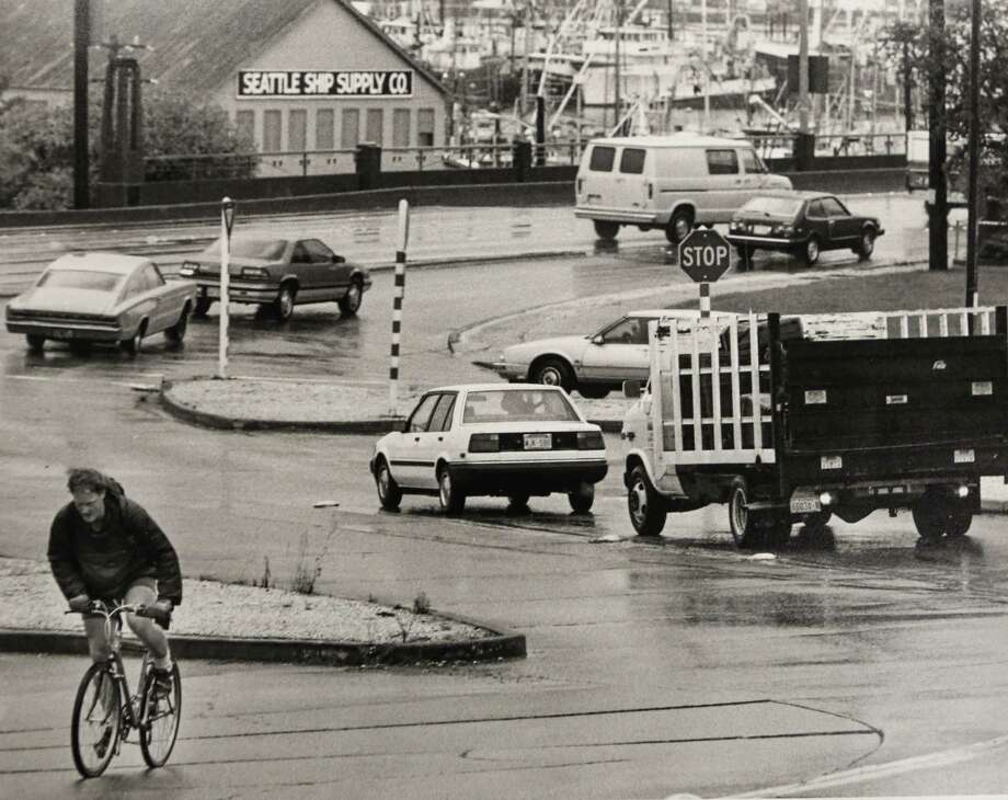 October 23, 1989 A bike rider passes Fishermen's Terminal. Photo: FILE PHOTO, SEATTLEPI.COM / SEATTLEPI.COM