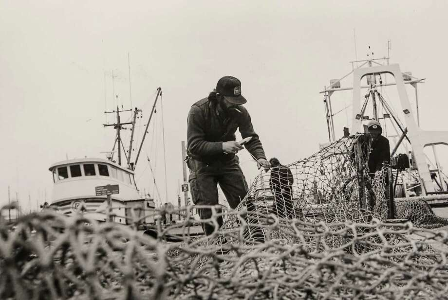 March 4, 1985 Roger Kurtz splices through the old net and repairs it with new line in preparation for a fishing trip aboard the Ocean Mariner, which is a 92-foot bottom fishing vessel.  Photo: FILE PHOTO, SEATTLEPI.COM / SEATTLEPI.COM