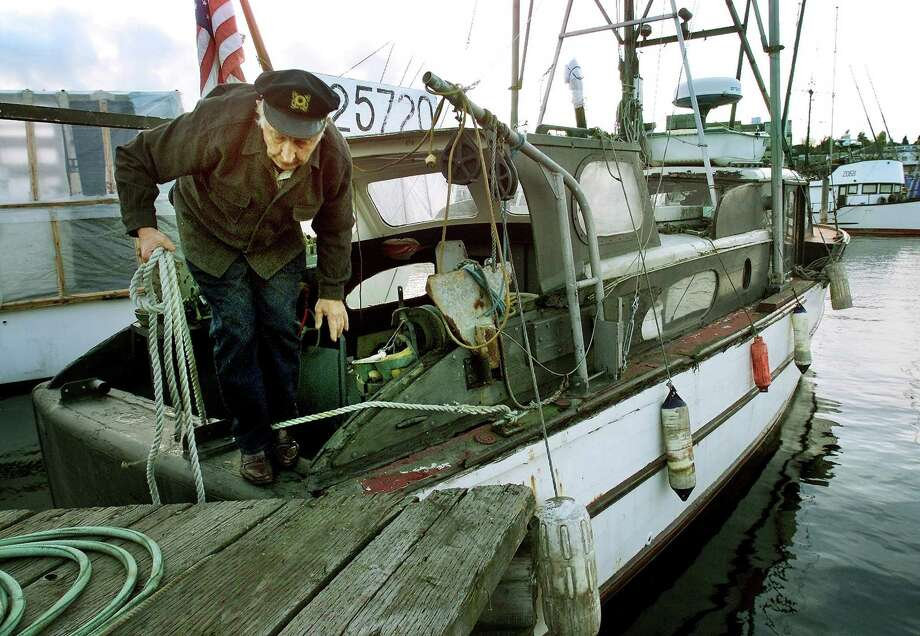 November 5, 2001 Fisherman Boyd Dingman steps off his vessel after docking it at the slip he's used for 30 years at Fishermen's Terminal.  Photo: FILE PHOTO, SEATTLEPI.COM / SEATTLEPI.COM