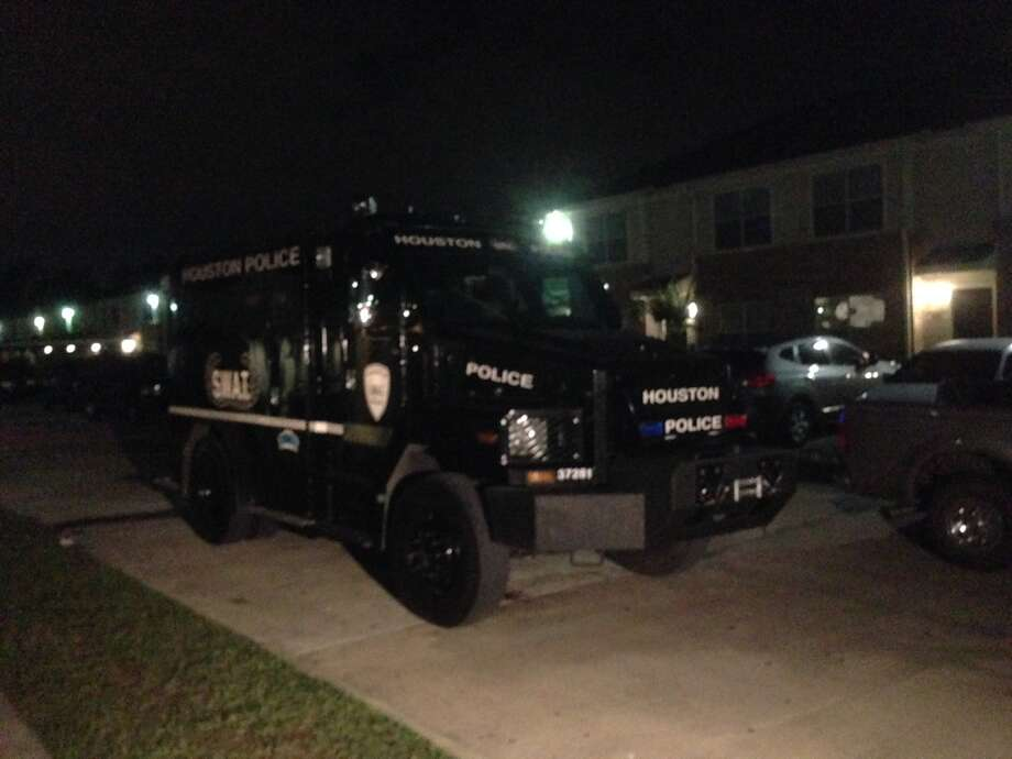 A SWAT team is shown at thePark at Humble apartments, 9390 FM 1960 West, late Wednesday after reports of a shooting. Photo: Mike Glenn, Chronicle