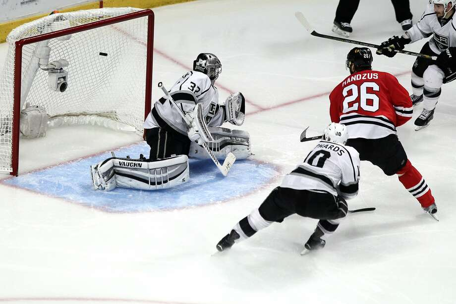 Michal Handzus (26) scores against Kings goalie Jonathan Quick in the second overtime as Chicago won Game 5 at home. Photo: Tasos Katopodis, Getty Images