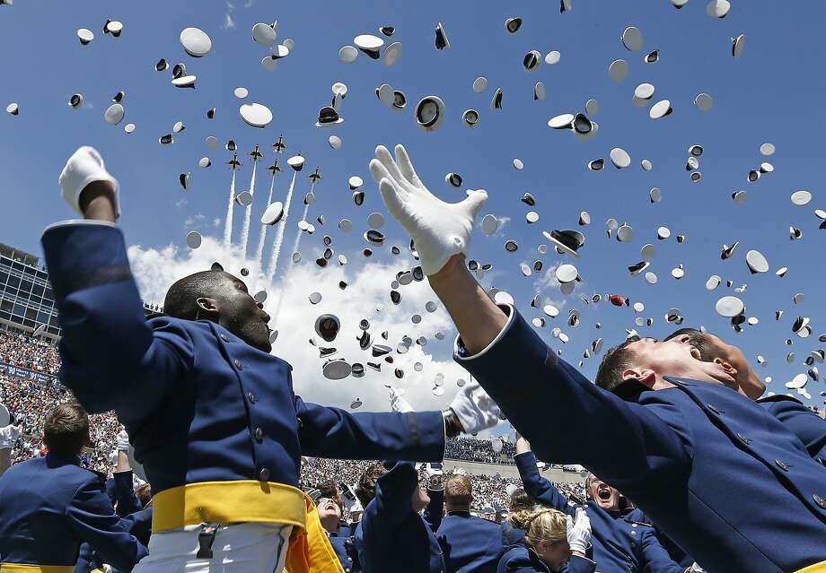 Air Force Academy graduates throw their caps into the air as F-16 jets from the Thunderbirds make a flyover, at the completion of the graduation ceremony for the class of 2014, at the U.S. Air Force Academy, in Colorado, Wednesday, May 28, 2014.  (AP Photo/Brennan Linsley) Photo: Brennan Linsley, Associated Press