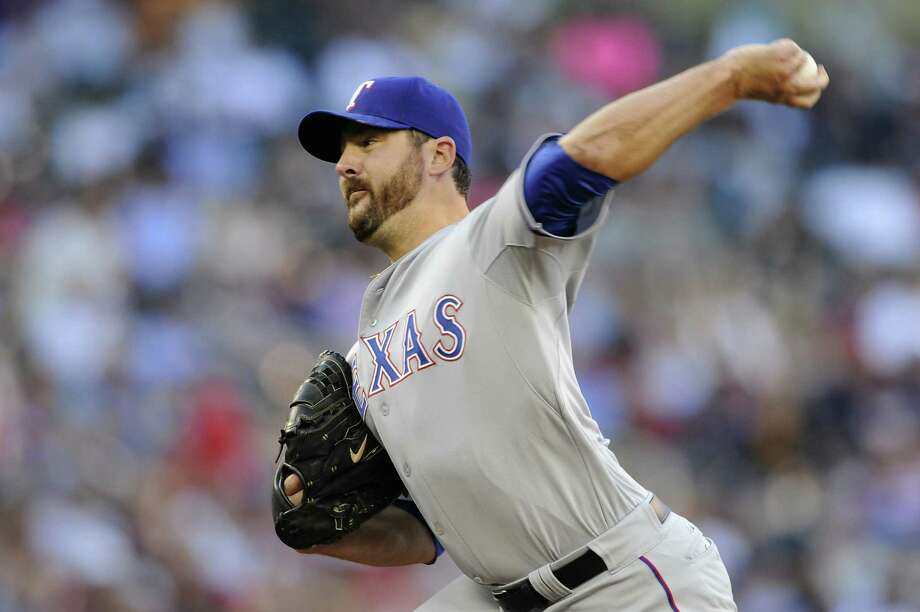 In his first start since early April, Joe Saunders pitched five shutout innings to lift the Rangers. Photo: Hannah Foslien / Getty Images / 2014 Getty Images