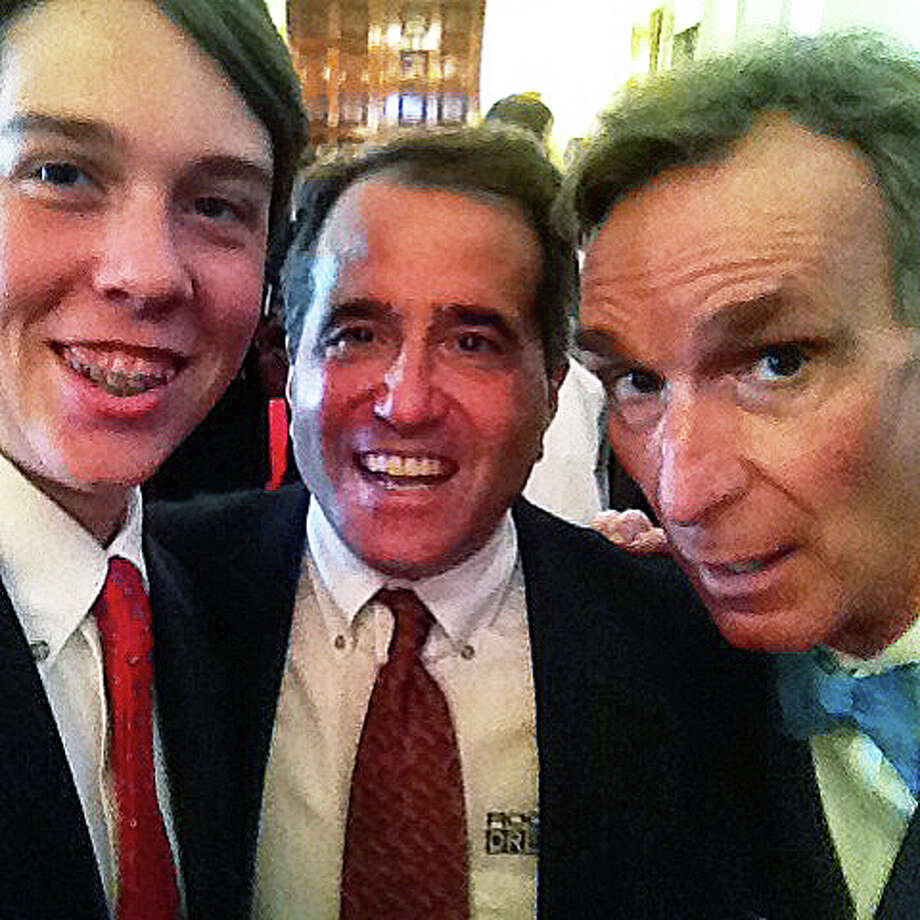 "Bill Nye, the ""Science Guy,"" right, at the White House Science Fair on Tuesday with Fairfield Country Day School student Thompson ""Tommy"" Whiteley, left, and Mark Grayson of Fairfield, CEO of Rocket21. Photo: Contributed Photo / Fairfield Citizen"