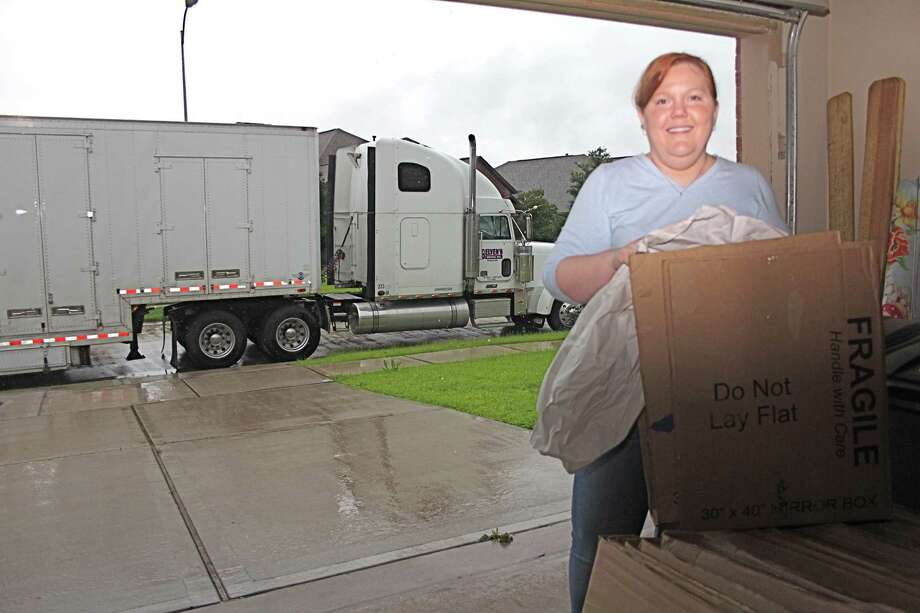 Nicole Woods, a resident  since January 2013 of Lakes of Bella Terra subdivision in Richmond, gets boxes out of the garage for packing. Her home sold only two days after it was listed.Nicole Woods, a resident  since January 2013 of Lakes of Bella Terra subdivision in Richmond, gets boxes out of the garage for packing. Her home sold only two days after it was listed. Photo: Suzanne Rehak, Freelance Photographer