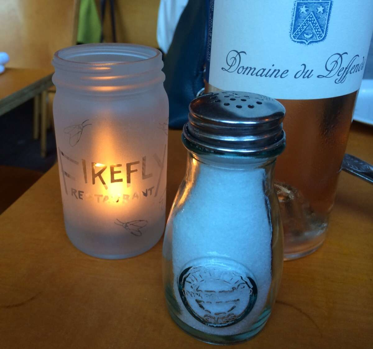 Each table at Firefly is set with candles with the restaurant's name and logo.