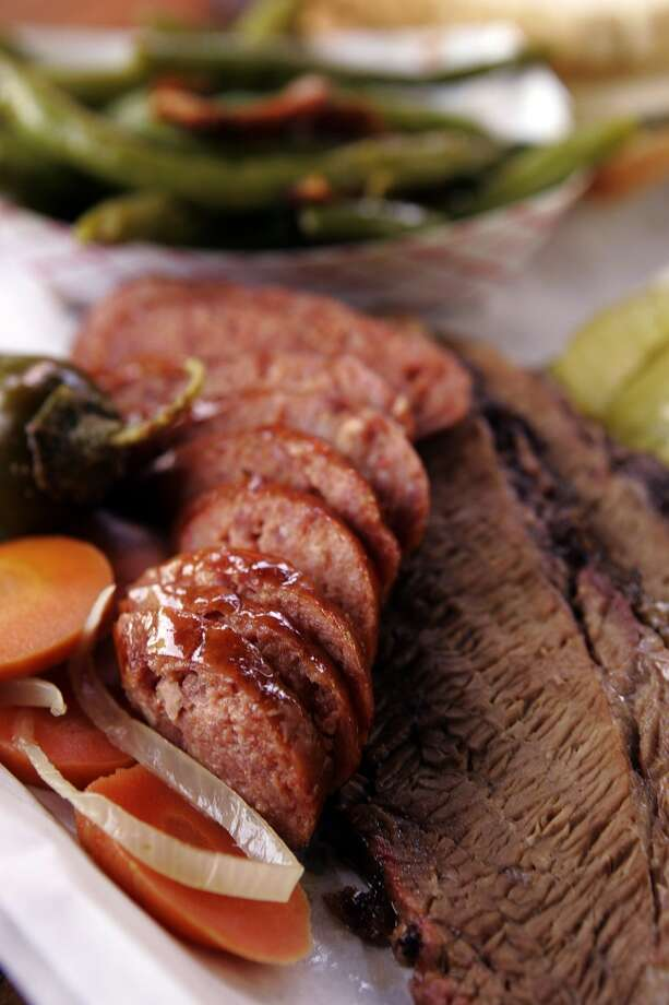 The brisket and sausage plate from Augie's Barbed Wire Smoke House. Photo: Kevin Geil, San Antonio Express-News