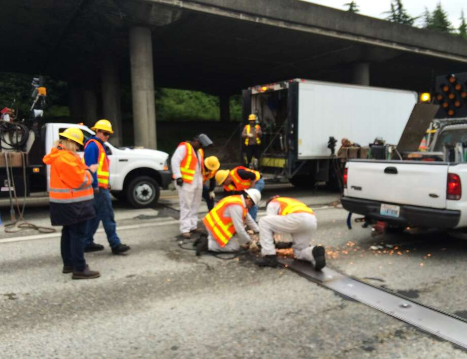 Crews try to repair the buckled section of Interstate 5 on Thursday, May 29, 2014. Photo by Joshua Trujillo/seattlepi.com