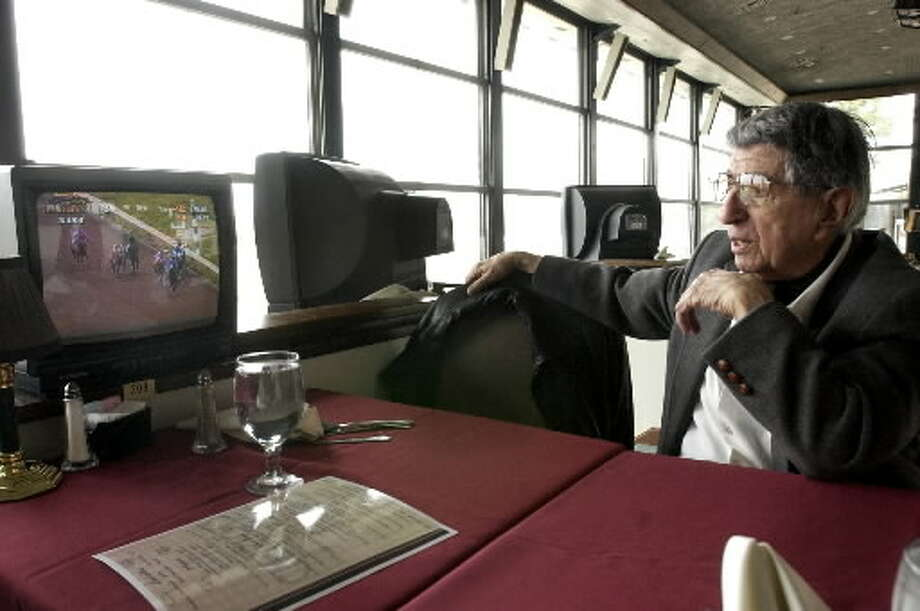 George Bookasta takes in a race at the Saratoga Harness Track on March 4, 2004. Bookasta, who got his start in movies as a child actor in the silent era, was a race horse owner who moved to Saratoga Springs several years ago. He died in March. (Will Waldron / Times Union archive)
