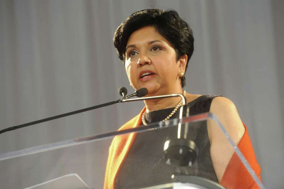 Indra Nooyi, CEO and chairman of Pepsi, speaking at the Breast Cancer Alliance's benefit luncheon and fashion show at the Hyatt Regency Greenwich, on Thursday, Oct. 28, 2010. The Greenwich resident was ranked by Forbes on Thursday as the world's 13th most powerful woman. Photo: Helen Neafsey, ST / Greenwich Time