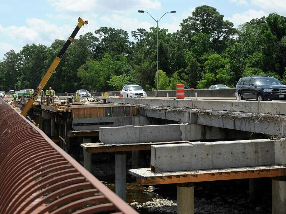 The Woodlands Parkway bridge, over Lake Woodlands, still has a way to go before it is finished. Construction on the bridge project was scheduled to be finished last December, but is way behind schedule. Photo by David Hopper Photo: David Hopper, Freelance / freelance