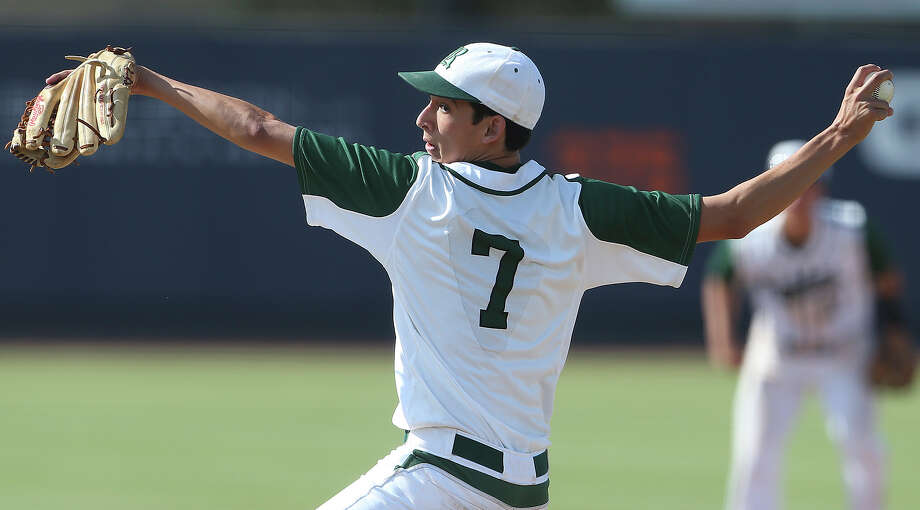 Rattler pitcher Troy Montemayor stretches into a throw in the second game as Reagan plays Corpus Christi King in 5A regional quarterfinal baseball at UTSA on May 17, 2014. Photo: TOM REEL