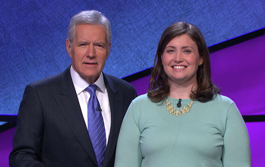 "In this January 2014 photo provided by Jeopardy Productions, Inc., shows Alex Trebek, host of the TV show ""Jeopardy!,"" poses with contestant Julia Collins, 31, of Kenilworth, Ill., during the taping of her shows on stage at JEOPARDY!, Sony Pictures Studios, Culver City, Calif. On a show that aired Tuesday, May 27, 2014, Collins won her 17th straight game on Jeopardy! and has won more games than all but two other contestants in the history of the show. Photo: Courtesy Of Jeopardy Productions, Inc., AP / Jeopardy Productions, Inc."
