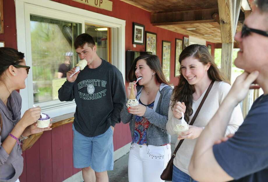 Newtown residents, from left, Kate Bartel, Taylor Steimle, Emily Broe, Sam Steimle, and Connor Smith enjoy ice cream at Ferris Acres Creamery in Newtown, Conn. Wednesday, May 14, 2014.  The family farm has been around since 1964, passsed down from generation to generation, and is currently owned by Charles Ferris III along with his wife and kids. Photo: Tyler Sizemore / The News-Times