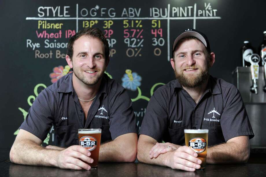 B-52 Brewery co-owners Chad Daniel, left, and Brent Daniel host the grand opening of the B-52 Brewery in Conroe. Photo: Eric Christian Smith, Freelance