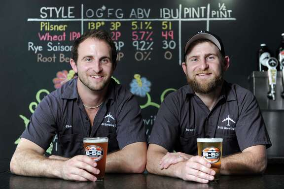B-52 Brewery co-owners Chad Daniel, left, and Brent Daniel host the grand opening of the B-52 Brewery in Conroe.