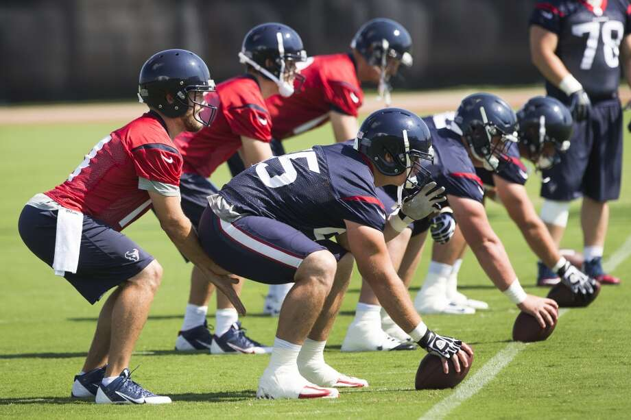 Texans quarterback Ryan Fitzpatrick, left, lines up to take the snap from center Chris Myers. Photo: Brett Coomer, Houston Chronicle