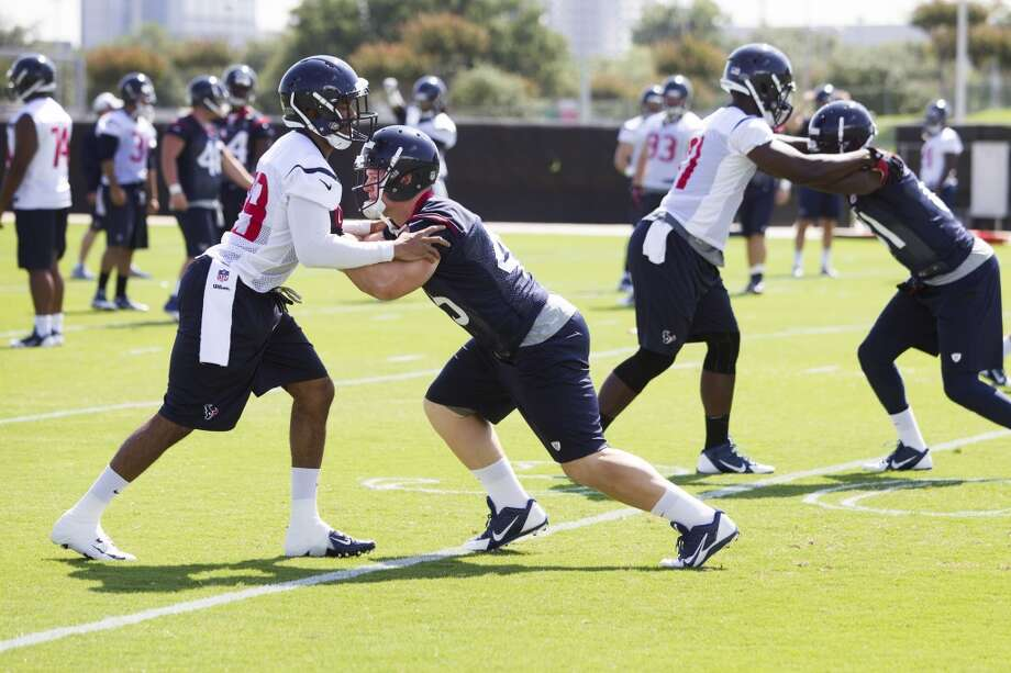 Texans safety Jawanza Starling, left, lines up against fullback Jay Prosch during a special teams drill. Photo: Brett Coomer, Houston Chronicle