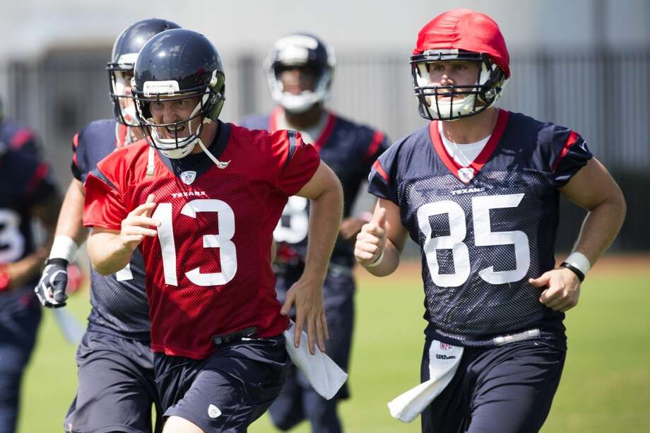 Texans quarterback T.J. Yates (13) and tight end Chris Coyle (85) jog across the field. Photo: Brett Coomer, Houston Chronicle