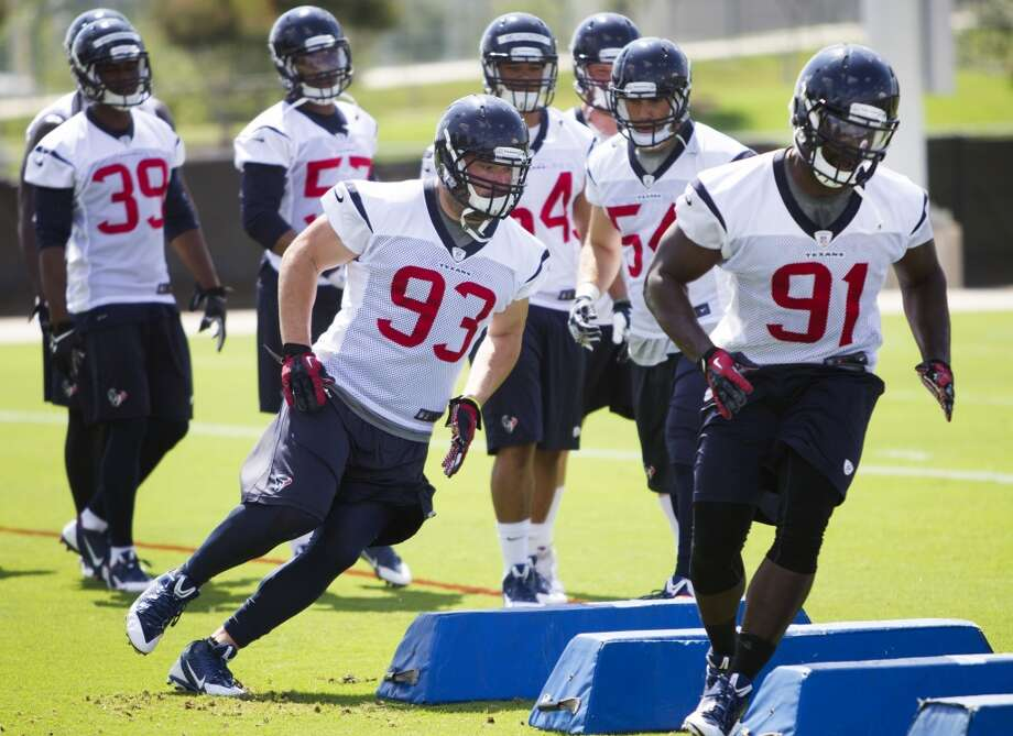 Texans defensive end Jared Crick (93) and linebacker Ricky Sapp (91) run a drill. Photo: Brett Coomer, Houston Chronicle