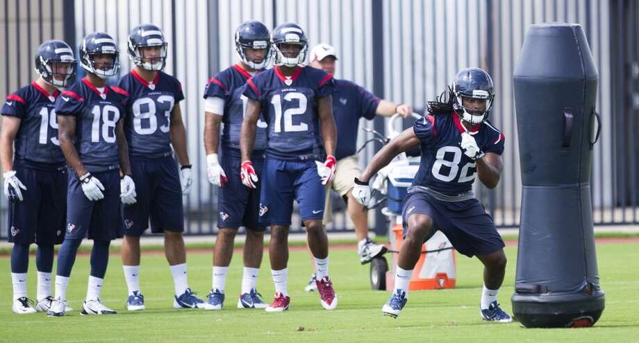 Texans wide receiver Keshawn Martin (82) runs a drill. Photo: Brett Coomer, Houston Chronicle