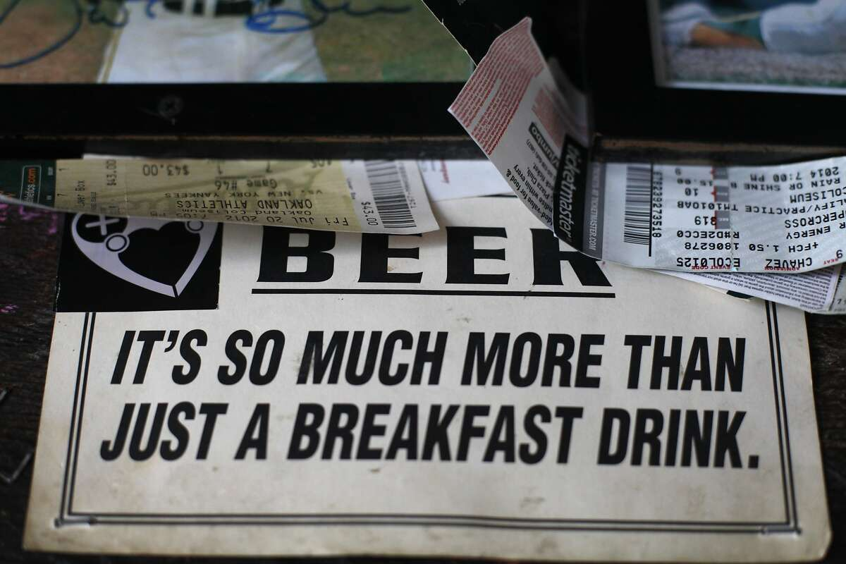 A sign is tucked in amongst the sports memorabilia covering the walls at Kingfish on May 28, 2014 in the Temescal neighborhood of Oakland, Calif. Kingfish is scheduled to move around the corner by the end of the year.