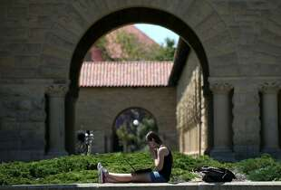STANFORD, CA - MAY 22:  A woman works on a laptop on the Stanford University campus on May 22, 2014 in Stanford, California. According to the Academic Ranking of World Universities by China's Shanghai Jiao Tong University, Stanford University ranked second behind Harvard University as the top universities in the world. UC Berkeley ranked third.  (Photo by Justin Sullivan/Getty Images)