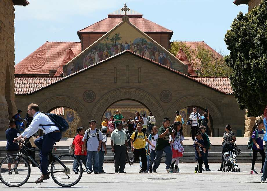 STANFORD, CA - MAY 22:  A group of school kids tours the Stanford University campus on May 22, 2014 in Stanford, California. According to the Academic Ranking of World Universities by China's Shanghai Jiao Tong University, Stanford University ranked second behind Harvard University as the top universities in the world. UC Berkeley ranked third.  (Photo by Justin Sullivan/Getty Images) Photo: Justin Sullivan, Getty Images