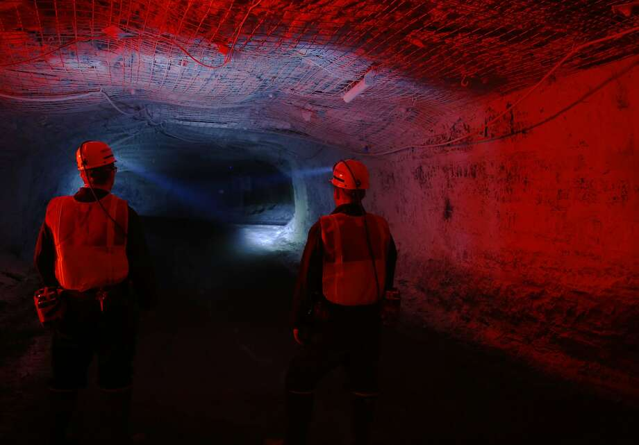 Utah officials look over a tunnel at the Sufco Coal Mine, 30 miles east of Salina, Utah. The mine produces 30,000  tons of more environmentally friendly low-sulfur coal a day. Photo: George Frey, Getty Images