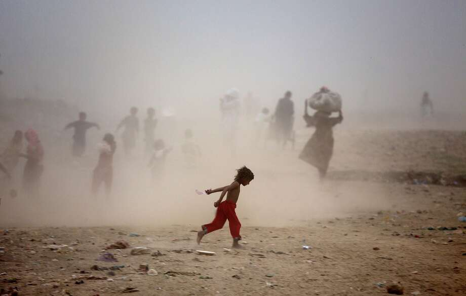 Roasted and sand-blasted: Amid a 100-degree-plus heat wave, Pakistanis get caught in a sand storm on 