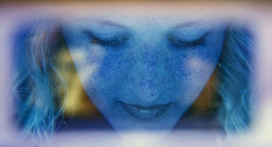 Too much tanning can turn you into a Smurf: At a health fair at Lincoln County High School in Stanford, Ky., a 