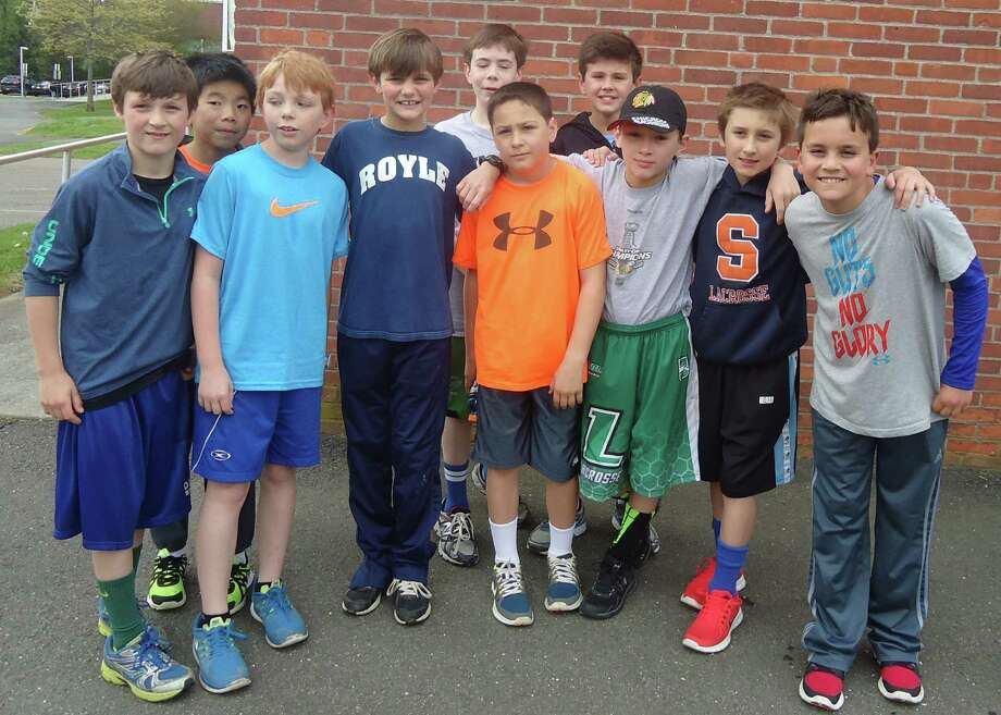 Members of Royle School's Let Me Run program will participate in Hope in Motion Sunday, June 1, in Stamford. In front from left, Charlie Silsby, Nicholas Liu, Julian Van Dijkum, Andrew Huffman, Jack Pond, Ryan Spengler, Charlie Feingold and Milo Carter; in back, Tom Frank and Alex de Castro. Photo: Contributed Photo, Contributed / Darien News