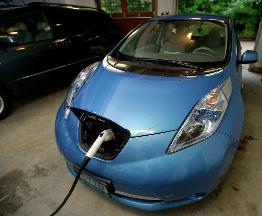 Etta Kantor's Nissan Leaf sits plugged into the wall of her New Canaan home on Thursday, June 13, 2013. Photo: Lindsay Perry / Stamford Advocate